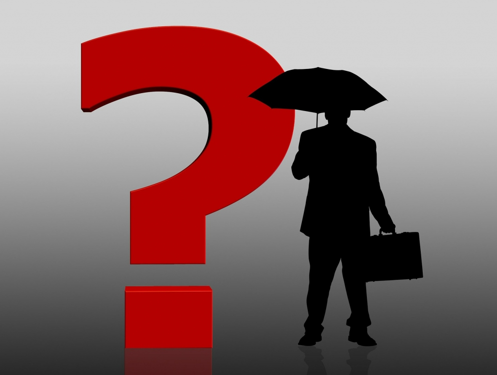 Man with umbrella and giant question mark beside him
