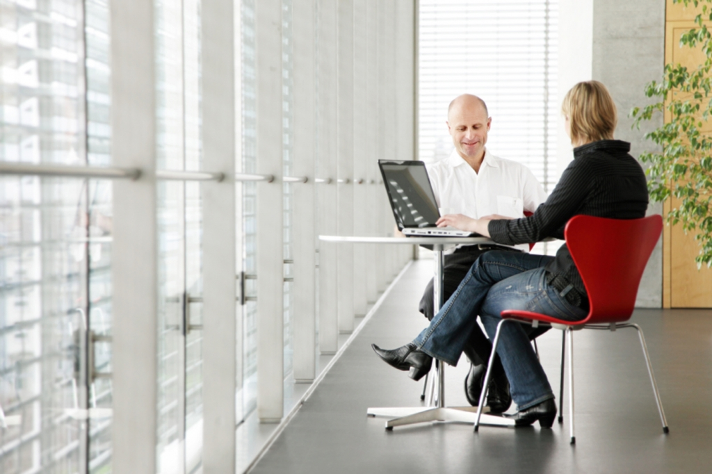 man and women in one-on-one business meeting
