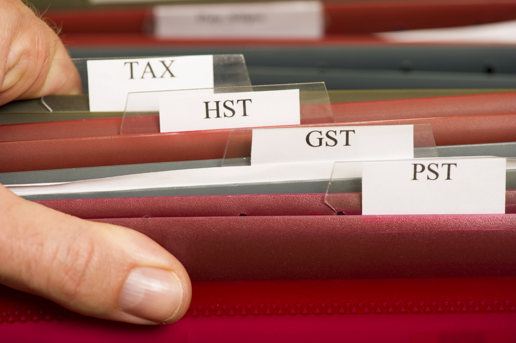 tax folders with HST GST and PST