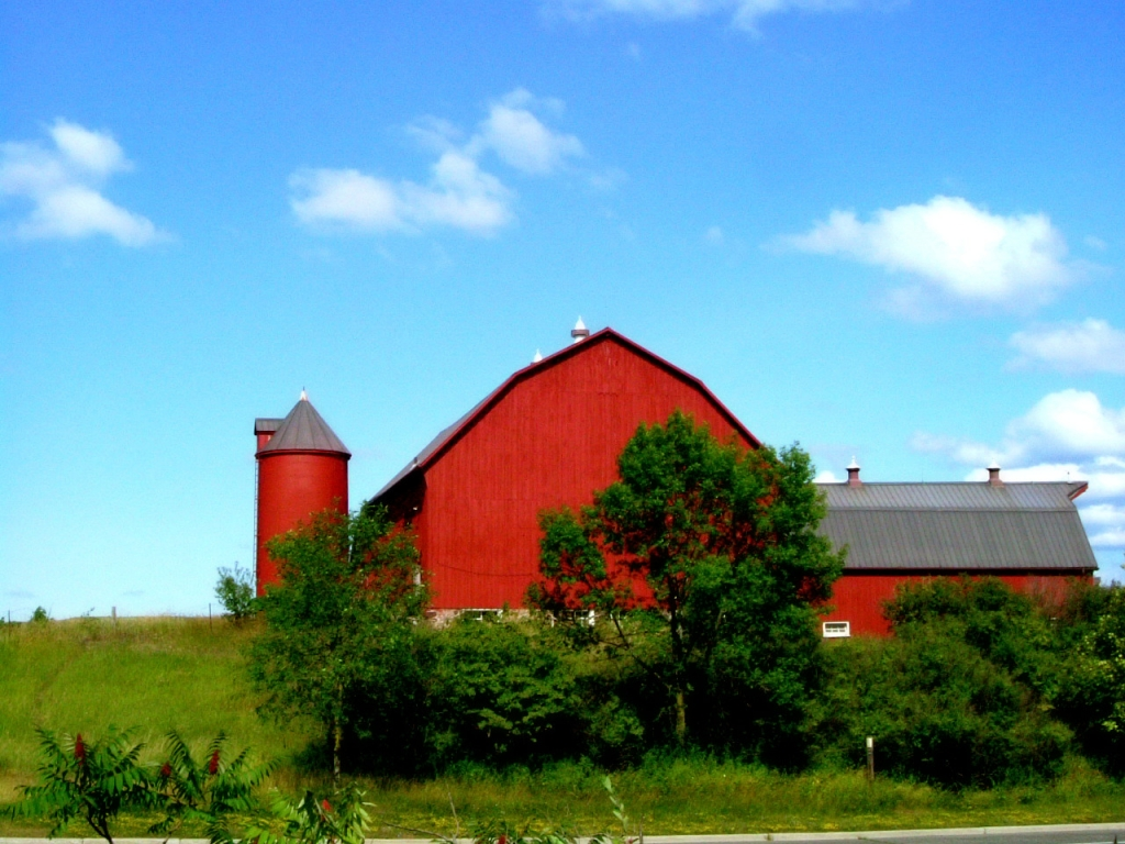 Red barn with farm landscape
