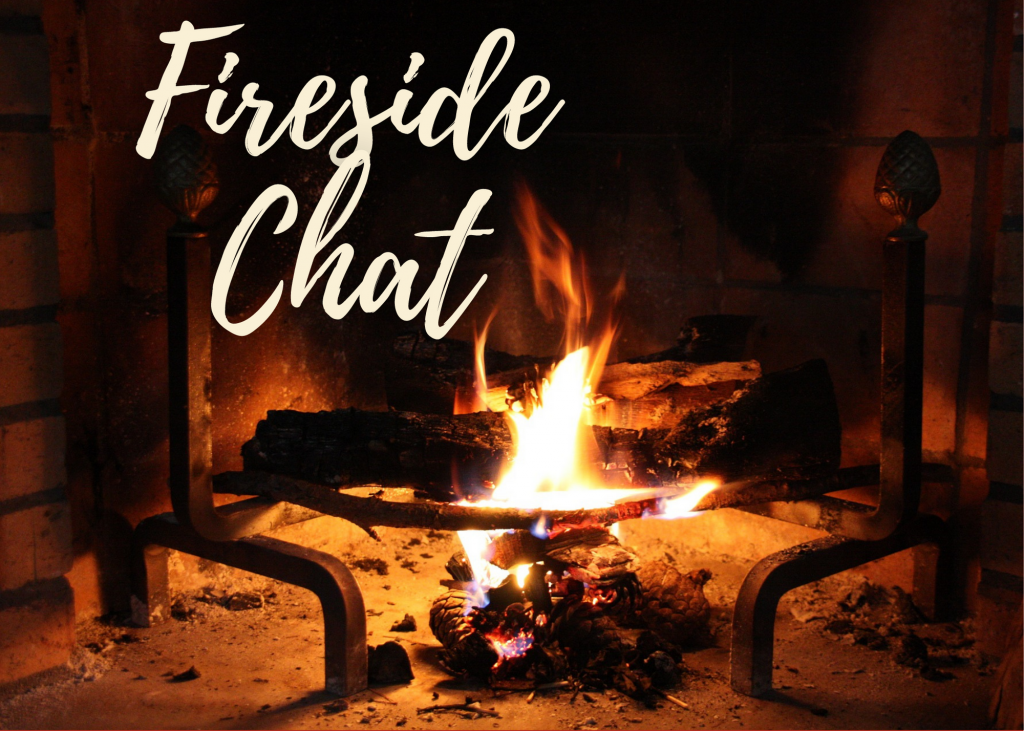 fireplace with glowing fire (words fireside chat on image)