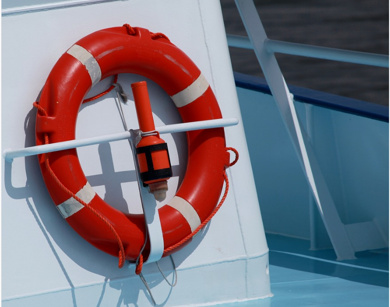 A lifebelt attached to the side of a white boat