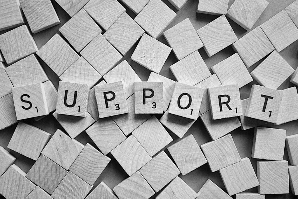 the word Support spelled out in scrabble tiles