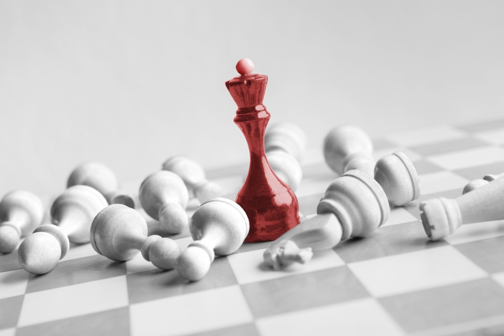 red chess queen beats whites on chessboard