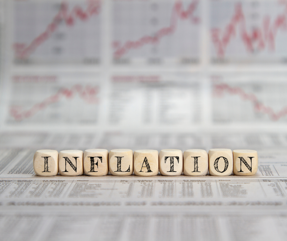 word inflation spelled out in blocks. red graphs faded in background